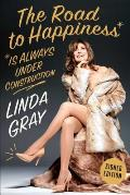 The Road to Happiness Is Always Under Construction Signed Edition